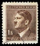 TYSK REICH Circa 1939 - c 1944: En portostämpel med att beskriva av Adolf Hitler royaltyfri foto