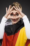 Tyskland för supporter för fotbollsportfan med hjärta royaltyfri foto