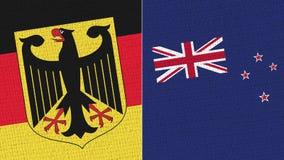 Tyskland och nyazeeländsk flagga - tygtextur vektor illustrationer