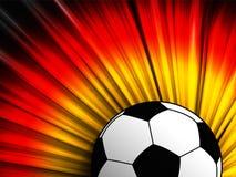 Tysklandflagga med bakgrund för fotbollboll Arkivfoto