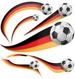 Tysklandflagga med fotbollbollen Arkivfoto