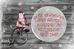 Tyskt julhälsningkort med glad xmas för text och succes royaltyfria bilder