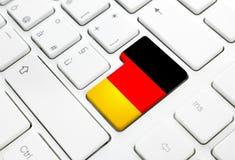 Tyskt språk eller Tysklandrengöringsdukbegrepp Nationsflaggan skriver in änden Arkivbilder