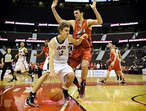 Men's CIS Basketball Finals. Tyson Hinz (white) in action for the Carleton Ravens in their match against Acadia Axemen at Scotiabank Place, Ottawa on March 9 stock images
