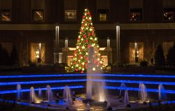 Tysons Corner at night. Christmas tree at Tysons Corner in the evening near the fountain Royalty Free Stock Photo