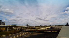 Tysons Corner Traffic. Time lapse video of freeway traffic and metro commuter train in tysons corner Virginia USA stock video footage