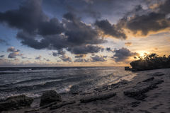 Tyst strand för solnedgång Royaltyfria Foton