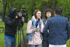 Tyumen, Russia, on August 18, 2018: The journalist and the video. Operator of one of TV channels of Tyumen interview royalty free stock photography