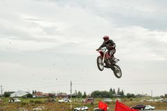 Motorcycle Jumping. Tyumen. Russia. Tyumen, Russia - August 6, 2005: Open championship of the Tyumen region in motorcycle sport cross-country race of memory of V royalty free stock image