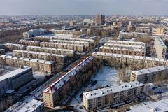 Bird eye view onto residential district. Tyumen. Tyumen, Russia - February 14, 2016: Aerial view on sleeping neighborhood large-panel houses on royalty free stock photography