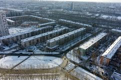 Bird eye view onto residential district. Tyumen. Tyumen, Russia - February 14, 2016: Aerial view on sleeping neighborhood large-panel houses on royalty free stock image