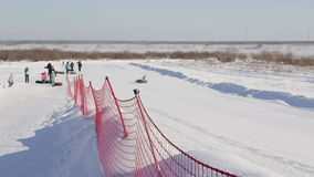 TYUMEN , RUSSIA - February 21, 2016, The ski resort  Voroninsky coaster in the open air in winter. Extreme fitness. People spend a weekend outdoors in winter stock footage