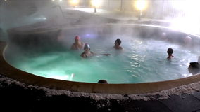 TYUMEN, RUSSIA, January 31.2016, People bathe in thermal springs in winter recreation complex. 'Upper Forest stock video