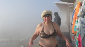 TYUMEN, RUSSIA, January 31.2016, woman comes out of the pool in the winter. In the thermal source stock video