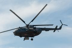 Russian military helicopter MI-8 in the cloudy sky Royalty Free Stock Photo