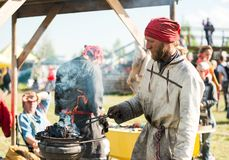 Blacksmith forges iron. Tyumen, Russia - June 15, 2019: Ethnofest `Heaven and Earth` - Annual All-Russian Cultural and Developing Ethno-Festival.  Blacksmith royalty free stock photography