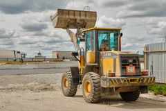 Bulldozer works on road construction in Tyumen. Tyumen, Russia - June 1, 2017: JSC Mostostroy-11. Construction of two-level outcome on bypass road on Stock Images