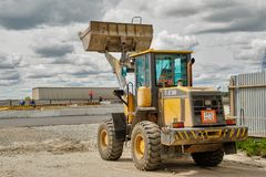 Bulldozer works on road construction in Tyumen. Tyumen, Russia - June 1, 2017: JSC Mostostroy-11. Construction of two-level outcome on bypass road on Stock Image