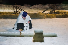 TYUMEN, RUSSIA, lake TARASKUL, JANUARY, 2017. Sanctification in the early morning water in the hole, in the Orthodox Christian fea Stock Photography