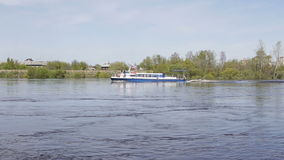 Tyumen, Russia - May 2016: cruise ship sailing on the river. Big ship with tourists swim on the pond in the summer stock video