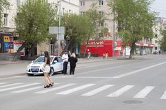 Tyumen, Russia, on May 9, 2019: Girls in short skirts cross the road on the crosswalk.  royalty free stock photos