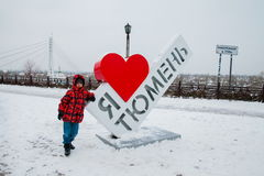 Tyumen, Russia - November 05.2016: Boy about  Art-object on quay Royalty Free Stock Photo