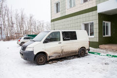 Tyumen, Russia - November 06.2016: Dirty minibus about the hotel Royalty Free Stock Photo