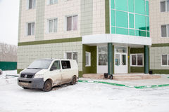Tyumen, Russia - November 06.2016: Dirty minibus about the hotel Stock Image