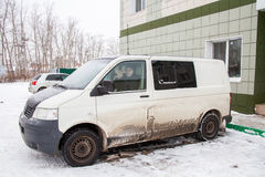 Tyumen, Russia - November 06.2016: Dirty minibus about the hotel Royalty Free Stock Photos