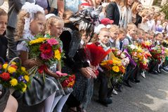 First-grade pupils and actor. Tyumen Royalty Free Stock Photos