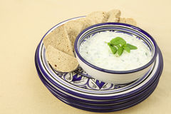 Tzatziki dip and plates Royalty Free Stock Image