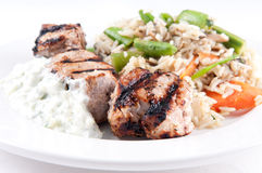 Tzatziki with grilled lamb kabobs, rice and vegetables. Stock Image