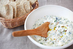 Tzatziki with herbs, chili and poppyseed crackers Stock Photography