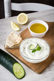Tzatziki and ingredients on a white wooden table stock images