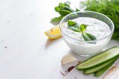 Tzatziki sauce ingredients, white wood background Stock Photography