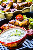 Tzatziki sauce. Tzatziki dressing. Tzatziki dressing with grilled chicken legs and fresh vegetable,lettuce leaf and cherry tomatoe Stock Photography