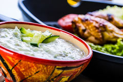 Tzatziki sauce. Tzatziki dressing. Tzatziki dressing with grilled chicken legs and fresh vegetable,lettuce leaf and cherry tomatoe Royalty Free Stock Image