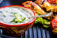 Tzatziki sauce. Tzatziki dressing. Tzatziki dressing with grilled chicken legs and fresh vegetable,lettuce leaf and cherry tomatoe Stock Photo