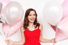 Uśmiechnięta kobieta z setem balony zdjęcie stock