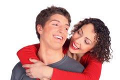 uścisk para uśmiecha się potomstwa fotografia stock