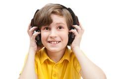 Uśmiech chłopiec słucha muzykę Zdjęcie Royalty Free