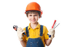 Uśmiech chłopiec trzyma budynków narzędzia Fotografia Stock