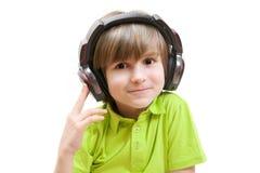 Uśmiech chłopiec z hełmofonami Obraz Royalty Free