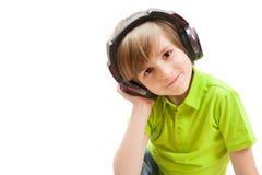 Uśmiech chłopiec z hełmofonami Fotografia Royalty Free