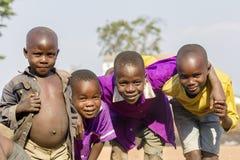 Uśmiechnięci afrykanów dzieciaki od Uganda Obrazy Royalty Free