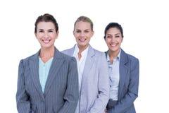 Uśmiechnięci młodzi bizneswomany w linii Zdjęcie Stock