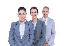 Uśmiechnięci młodzi bizneswomany w linii Obraz Stock