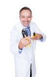 Uśmiechnięci samiec lekarki mienia cążki Zdjęcia Royalty Free