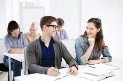 Uśmiechnięci ucznie z notatnikami przy szkołą Fotografia Stock