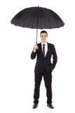 Uśmiechnięta biznesmen pozycja z otwartym parasolem Obrazy Royalty Free